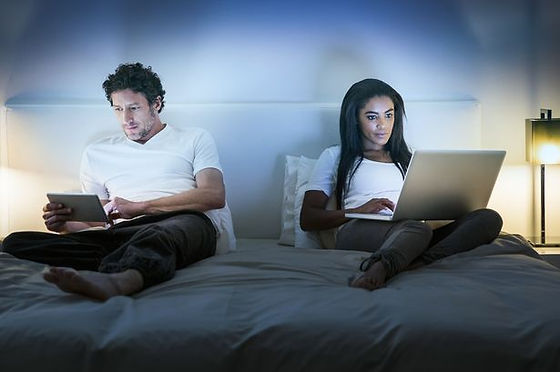 Couple-in-bed-using-laptop-and-tablet.jp