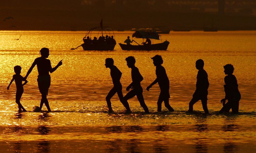 Devotees take a holy dip at the Sangam