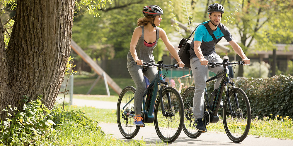 Couple on Unlimited Biking's e-bikes in Central Park