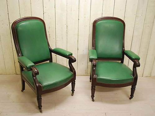 Pair of antique French upholstered mahogany open armchairs