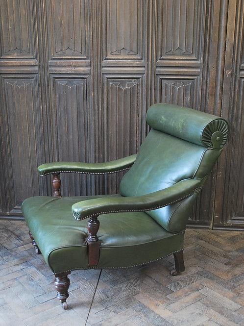 Antique leather open armchair