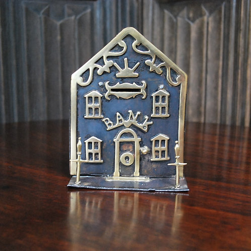 Iron and brass money box of a house