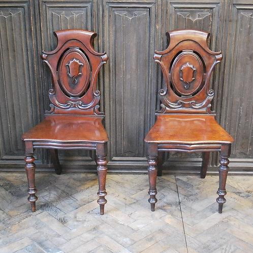Pair of Baronial mahogany hall chairs