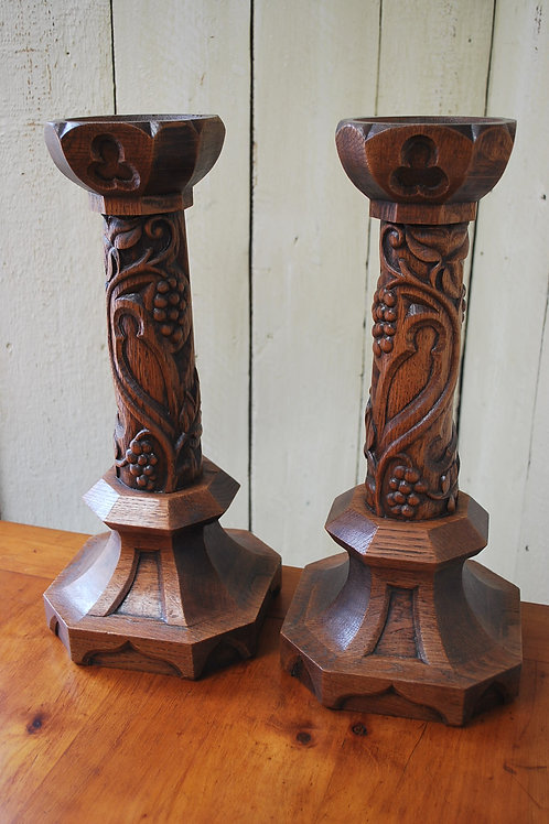 Pair of Gothic oak candlesticks