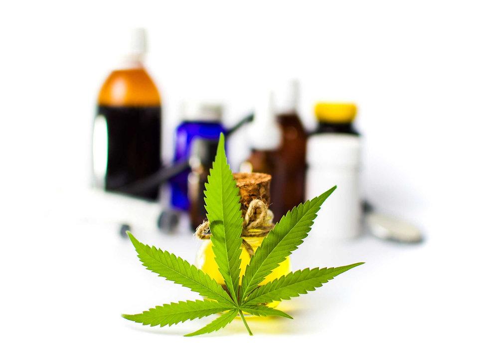 Marijuana-leaf-and-cannabis-oil-bottles-