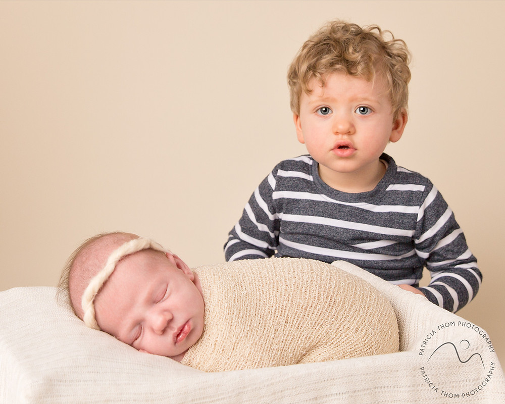 Big Brother and Baby girl wrapped by newborn photographer Patricia Thom Photography Aberdeen
