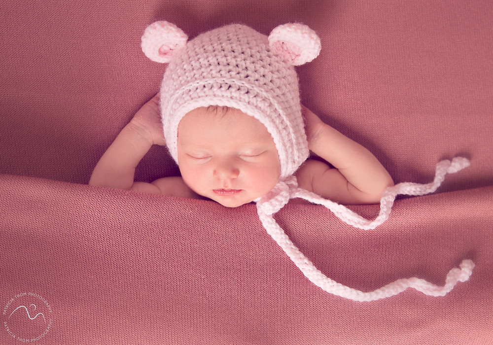 Baby girl wearing a pink hat