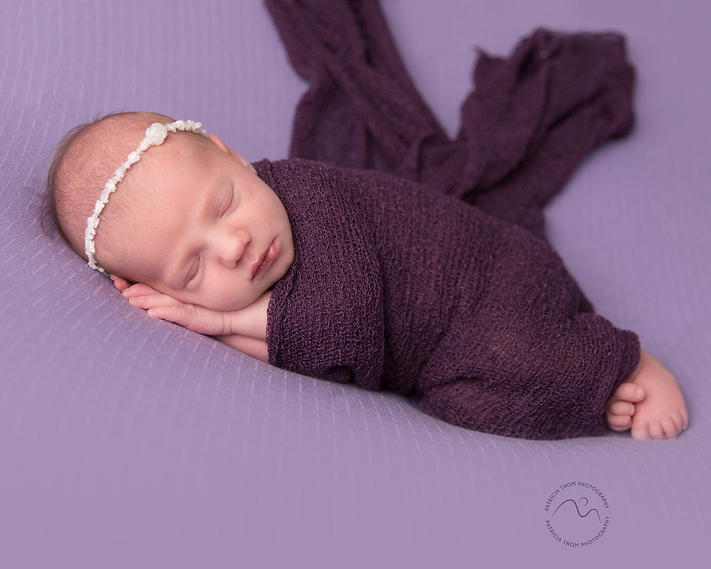 Baby girl wrapped by newborn photographer Patricia Thom Photography Aberdeen