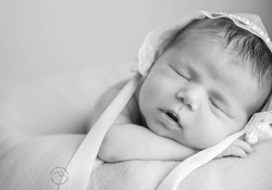 baby girl with hat close up Patricia Thom Photography