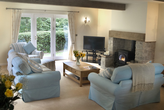 Main lounge area with TV and DVD player, log burner and access to rear garden