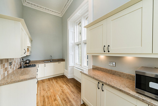 Small kitchen adjacent to lounge