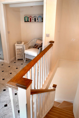 Stairs leading up to the top floor bathroom