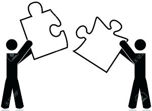 Puzzle - two guys holding pieces.jpg