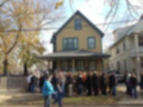 People waiting outside home.JPG
