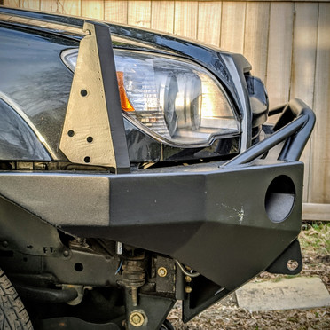 Designed and fabricated stake pockets and corner posts for Demello Off-Road bumper. Added functionality: brush guard, limb riser, and roof rack extension stabilizer mounting points.