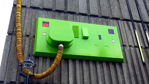 green-rectangular-corded-machine-on-grey