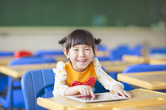 smiling kid using tablet  or ipad.jpg