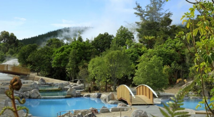 Pool and geothermal steam in the backgro