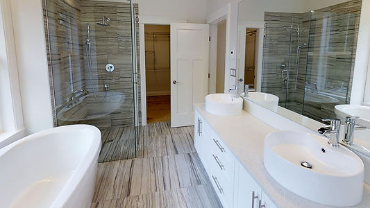 inteior designed ensuite with waterfall faucets