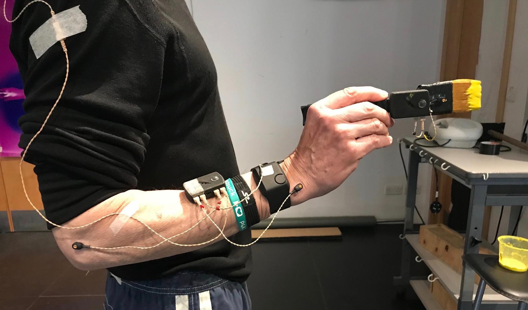 Participant holding brush / Sensors