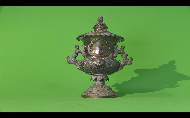 A silver cup won by cutter Neva in 1876.