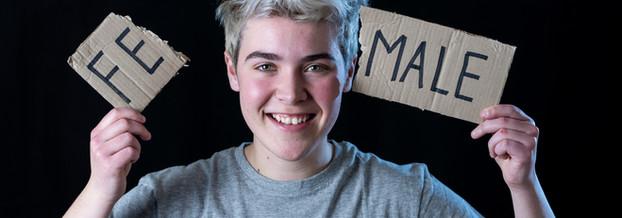 Handsome transgender teenager tearing th
