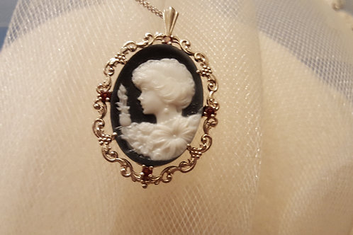 Carved Cameo and Garners set in Sterling Silver