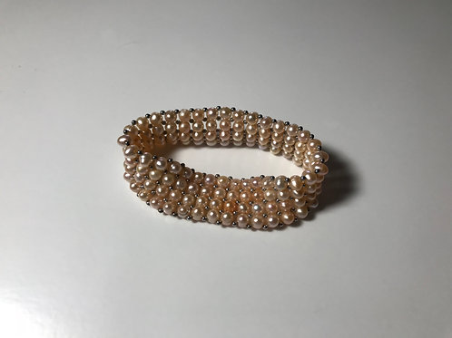 Peach colored Freshwater Pearl 4 Row Stretch Cuff Bracelet