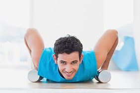 man-doing-push-ups-with-dumbbells-fitnes