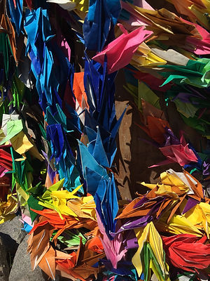 Jumble of folded paper cranes from memorial at Manzanar