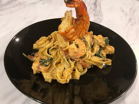 Tagliatelle Alfredo with shrimp, spinach and roasted red peppers