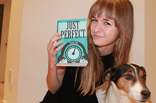 Proud author Hanne Arts posing with her debut novel Just Perfect