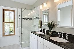 Bright white remodel bathroom. Glass sho