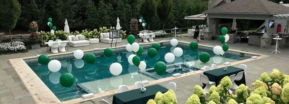Green And white balloon decor in pool.jp