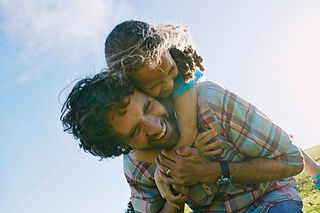 Father Carrying Child Outdoors