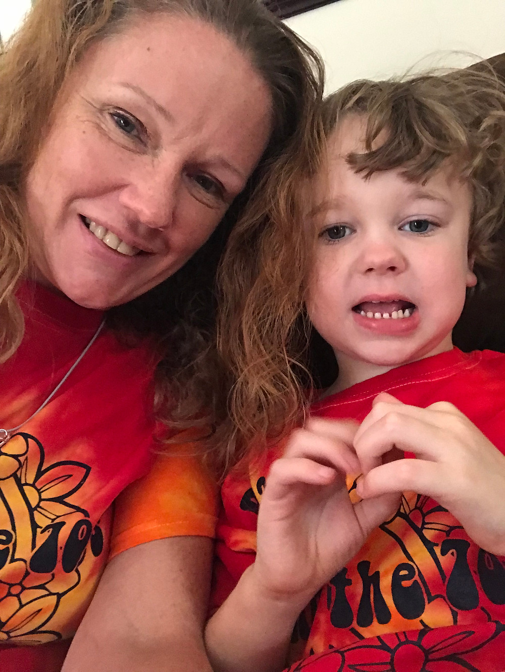 Micah and his mom are matching quite nicely in this picture. #TeamMicah