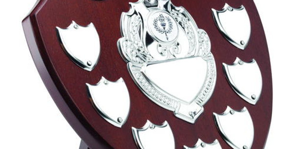 MAHOGANY SHIELD WITH CHROME FRONT AND 7 RECORD SHIELDS (1in SHIELD) - 9in