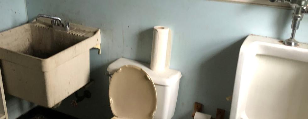 Sales office bathroom 1 - before