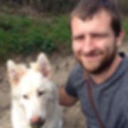 white german shepherd and dog walker