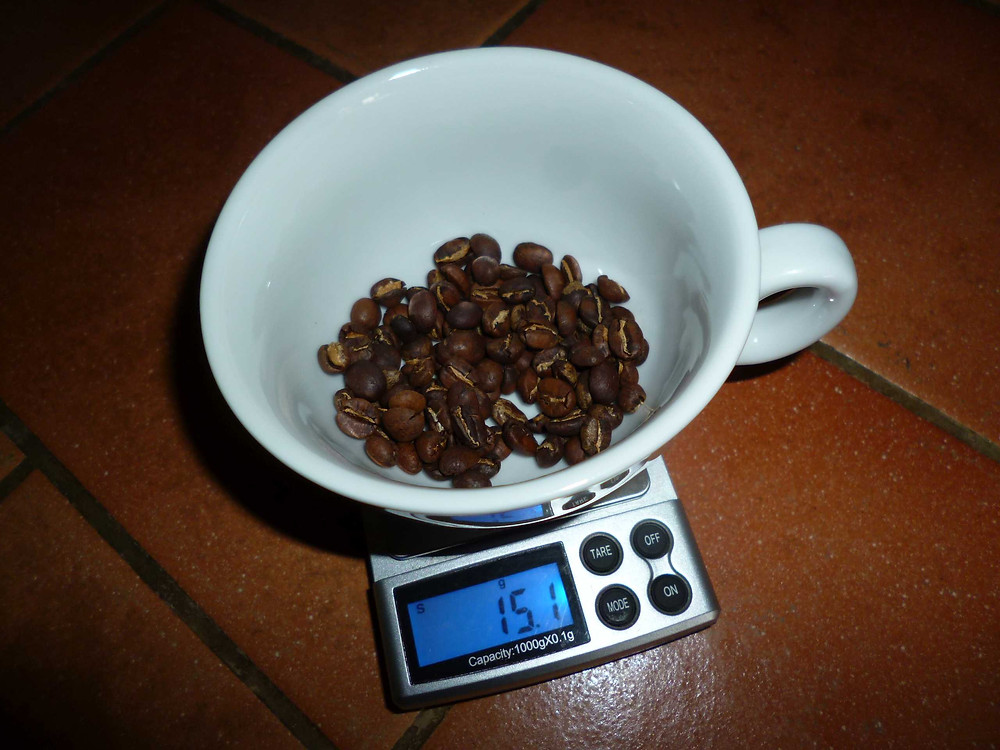 using scales to weigh coffee.JPG