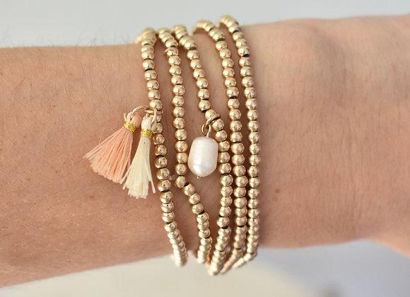 Pulseras perla y motitas