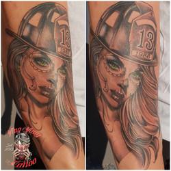Firefighter girl Tattoo von John