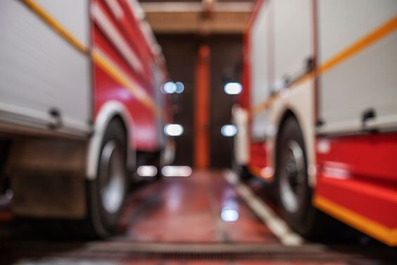 blurred-picture-fire-trucks-parked-fire-