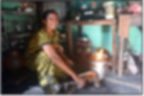Woman using clean cooking Greenway Smart Stove