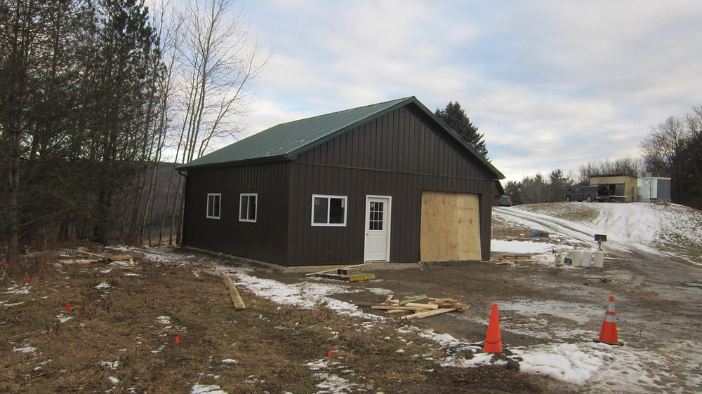 Pole barn building under construction