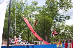 motorcycle swing acrobats