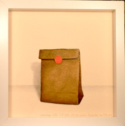 paper bag with red dot