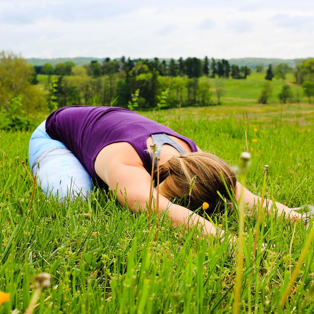 Lindsay-Bauer-Licensed-Therapist-doing-Yoga-childs-pose.jpg