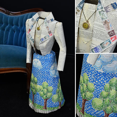 1910 paper dress made from painted pages of a French language primer and french stamps.