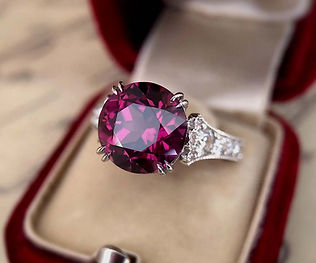 Faceted Mahenge Garnet in a custom-designed platinum and diamond ring